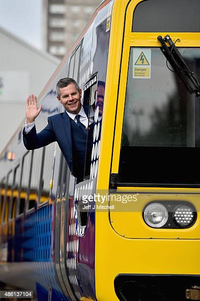 Scottish Transport Minister Derek Mackay unveils the first of 40 new look trains in a £14 million modernisation project at Knorr Bremse Rail services...