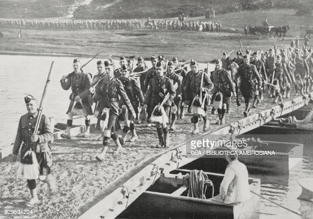 Scottish troops crossing a boat bridge France World War I photograph by Central New from L'Illustrazione Italiana Year XLI No 39 September 27 1914