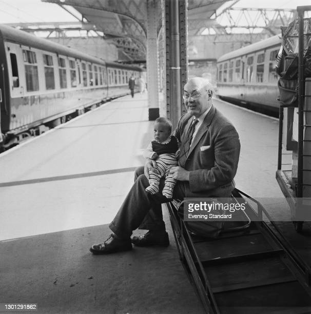 Scottish Unionist politician Patrick Maitland, 17th Earl of Lauderdale , with his grandson at a railway station, UK, 18th May 1973.