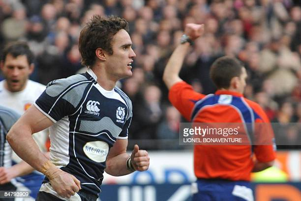 Scottish wing Thom Evans celebrates after he scored a try during their six Nations rugby union match France versus Scotland on February 14 2009 at...