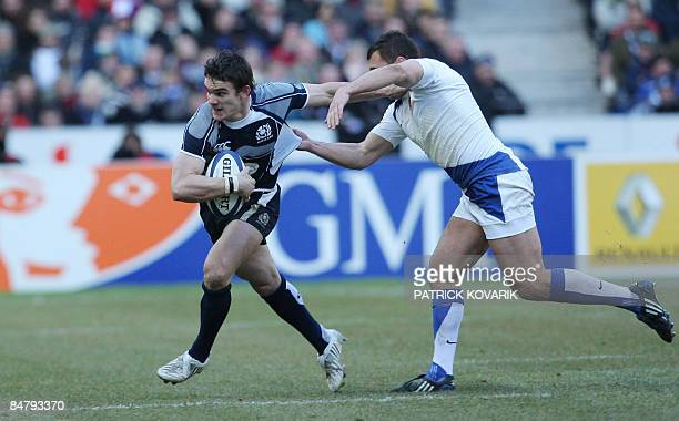 Scottish wing Thom Evans tries to escape a French defender during their six Nations rugby union match France versus Scotland on February 14 2009 at...