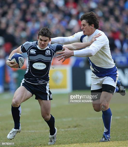 Scottish wing Thom Evans vies with a French defender during their six Nations rugby union match France versus Scotland on February 14 2009 at the...