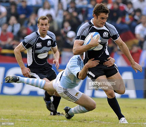 Scottish wing Thom Evans is tackled by Argentine centre Felipe Contepomi during the rugby union international test match between Argentina and...