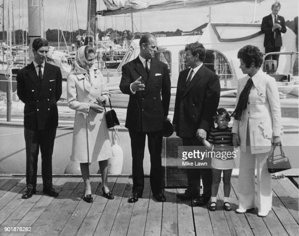 Scottish yachtsman Chay Blyth is met by Prince Charles Princess Anne and Prince Philip as well as his wife Maureen and daughter Samantha as he...