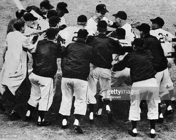 """Scottish-born American professional baseball player Bobby Thomson is mobbed by happy teammates after he hit the """"Shot heard 'round the world"""" homerun..."""