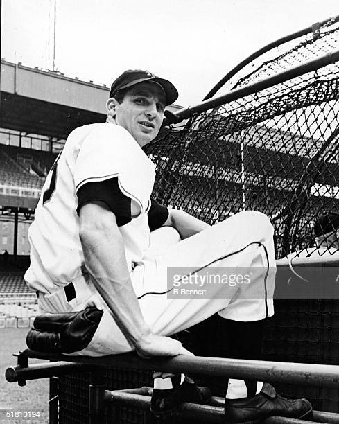 Scottish-born American professional baseball player Bobby Thomson of the New York baseball Giants sits on a railing at the Polo Grounds, New York,...