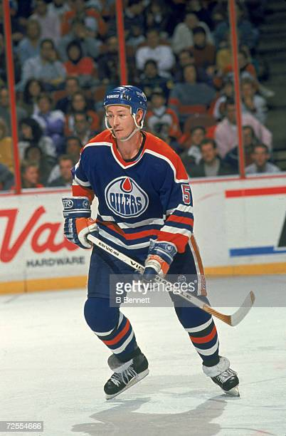 Scottishborn Canadian professional ice hockey player Steve Smith of the Edmonton Oilers skates on the ice during a game against the Philadelphia...