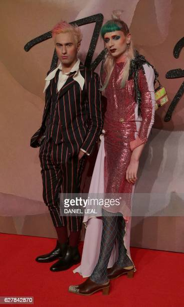 Scottishborn fashion designer Charles Jeffrey poses for pictures on the red carpet upon arrival to attend the British Fashion Awards 2016 in London...