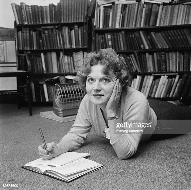 Scottishborn novelist Muriel Spark makes notes while lying on the floor 25th May 1960