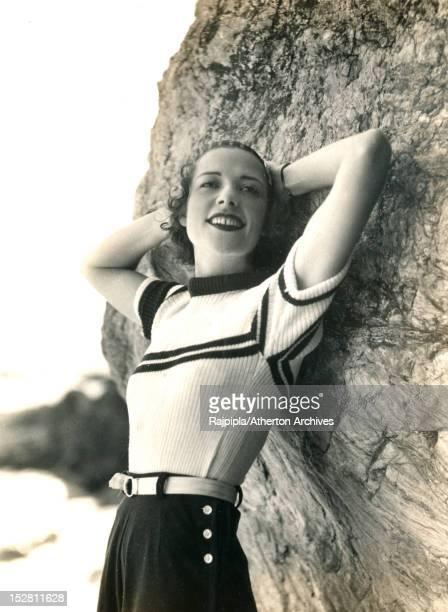 Scottishborn silent film actress and model Ella Atherton posing in a sweater 1930 Atherton later married Maharajah Vijayasinhji of Rajpipla becoming...