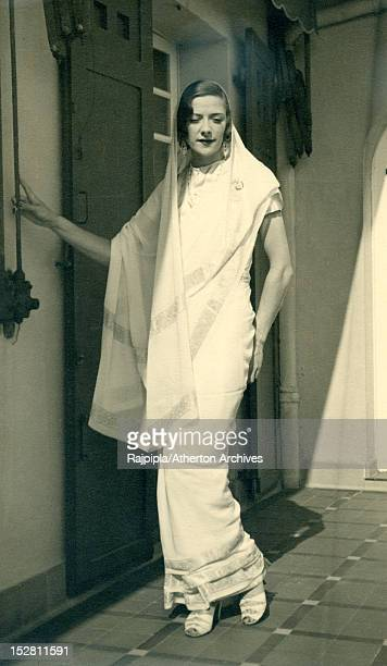 Scottishborn silent film actress and model Ella Atherton wearing a sari at Vijay Palace Rajpipla Gujarat India 1933 Atherton later married Maharajah...