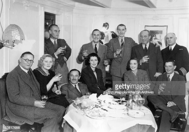 Scottishborn silent film actress and model Ella Atherton with friends on board the Cunard liner RMS Berengaria December 1937 Among the group are Bert...