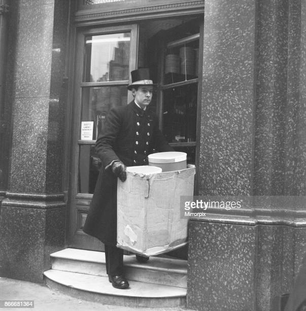 Scotts' the Hatter delivery man seen here dressed in full dress uniform, loading the days deliveries to London clients, 19th March 1954.