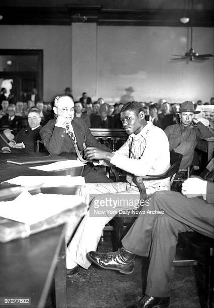 Scottsboro Case Before the amused gaze of his attornye Samuel Leibowitz Haywood Patterson first of the seven defendants to face court in retrial of...