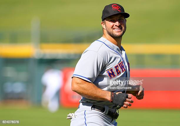 Scottsdale Scorpions Outfielder Tim Tebow warms up before a game between the Scottsdale Scorpions and the Mesa Solar Sox on November 17 2016 at Sloan...