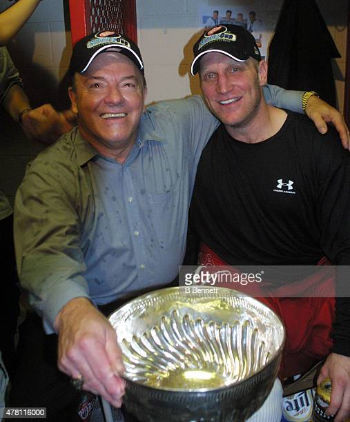 Scotty Bowman and Brett Hull of the Detroit Red Wings celebrate a Stanley Cup victory on June 14 2002 at the Joe Louis Arena in Detroit Michigan