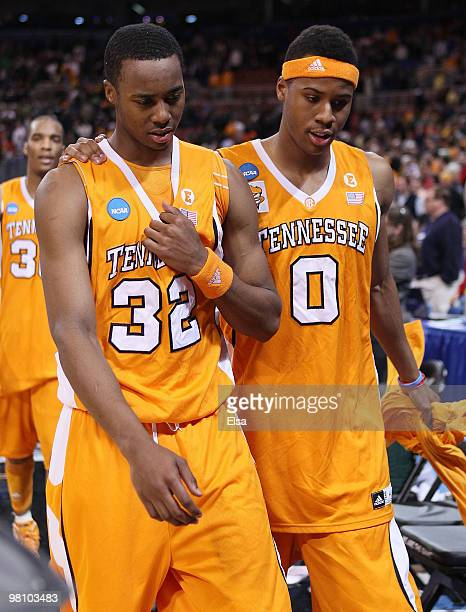 Scotty Hopson and Renaldo Woolridge of the Tennessee Volunteers walk off the court after the loss to the Michigan State Spartans during the midwest...