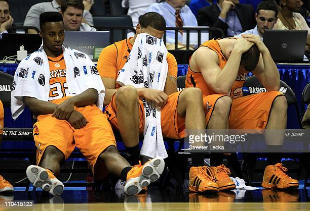 Scotty Hopson Brian Williams and Steven Pearl of the Tennessee Volunteers sit on the bench late in the second half before losing to the Michigan...