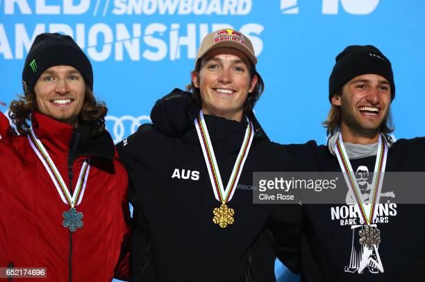 Scotty James of Australia celebrates winning the gold medal with silver medallist Iouri Podladtchikov of Switzerland and bronze medallist Patrick...
