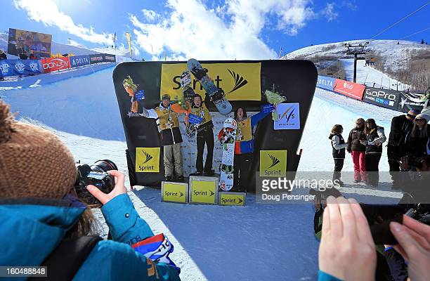 Scotty Lago of the USA in second place Shaun White of the USA in first place and Luke Mitrani of the USA in third place take the podium for the men's...