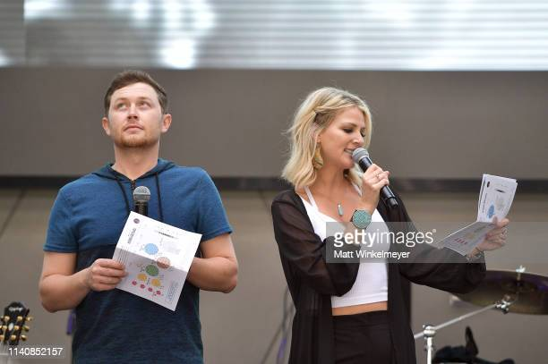 Scotty McCreery and Jennifer Wayne speaks onstage during the ACM Lifting Lives TOPGOLF TeeOff at TOPGOLF on April 06 2019 in Las Vegas Nevada