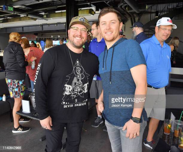Scotty McCreery and Mitchell Tenpenny attend the ACM Lifting Lives TOPGOLF TeeOff at TOPGOLF on April 06 2019 in Las Vegas Nevada