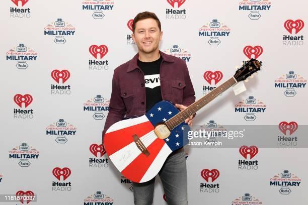Scotty McCreery backstage at the iHeartCountryOneNightForOurMilitary Presented by Rocheat the Country Music Hall of Fame on November 07 2019 in...