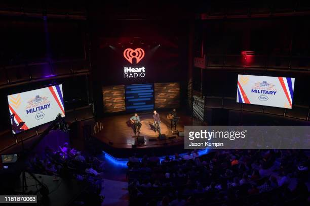Scotty McCreery performs during iHeartCountryOneNightForOurMilitary Presented by Rocheat the Country Music Hall of Fame on November 07 2019 in...