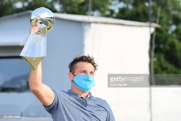 Scotty Miller of the Tampa Bay Buccaneers holds up the Vince Lombardi Trophy during the final round of the Valspar Championship on the Copperhead...