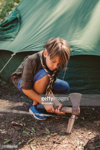 scout building a tent - cochlear implant stock pictures, royalty-free photos & images