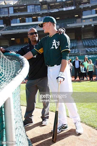 Scout Erik Martins of the Oakland Athletics talks with Athletics first round draft pick Matt Chapman on the field prior to the game against the Texas...