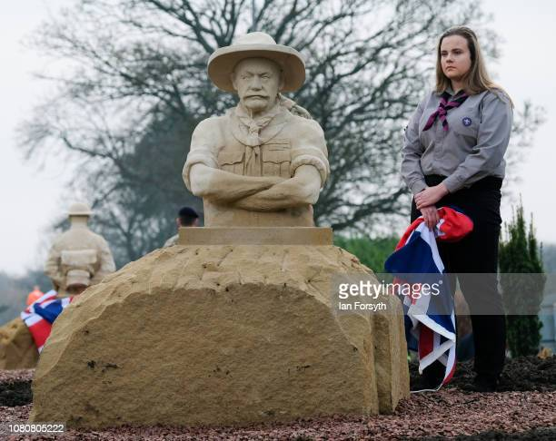 Scout stands next to a sculpture of The Lord BadenPowell during an unveiling by former Royal Engineer and Dunkirk veteran David Evans from Leyburn...