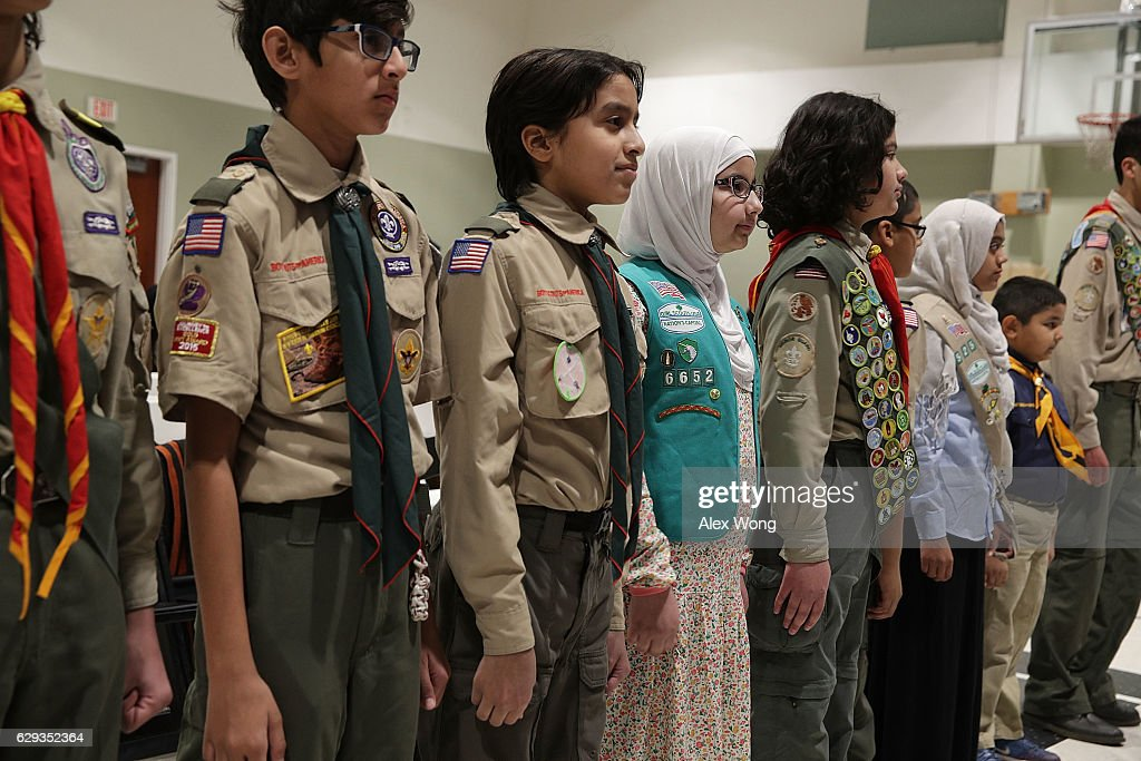 Scout troops members participate in an event at All Dulles Area Muslim Society (ADAMS) Center December 12, 2016 in Sterling, Virginia. U.S. Attorney General Loretta Lynch spoke to religious leaders and community members about the Department of Justice's efforts to combat hate crimes.