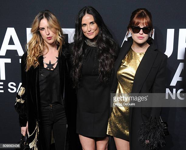 Scout Willis actress Demi Moore and Tallulah Willis attend the Saint Laurent show at The Hollywood Palladium on February 10 2016 in Los Angeles...