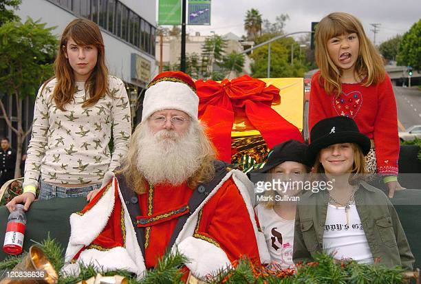 Scout Willis Santa guest Tallulah Willis and guest in red