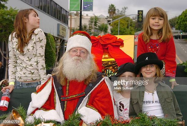 Scout Willis, Santa, guest, Tallulah Willis and guest in red