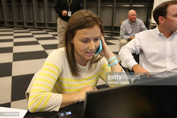Scouting Assistant Kate Greenthal of the Oakland Athletics talks on the phone in the war room during the first day of the MLB Draft at the...