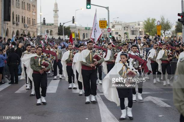 Scouts' bands parade in front of Al Esbat Gate of the Jerusalem's Old City during 'Palm Sunday' celebrations in Jerusalem on April 14 2019 Palm...