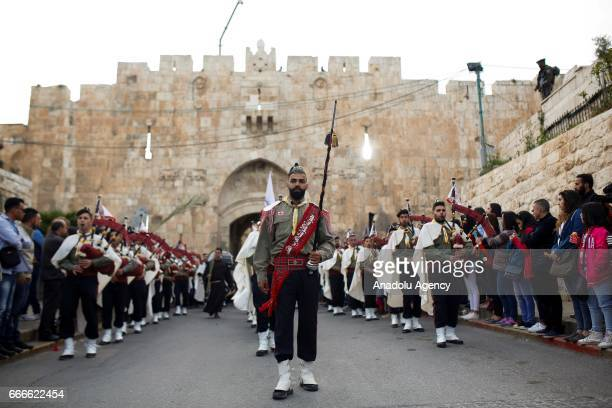 Scouts' bands parade in front of Bab esSahire of the Jerusalem's Old City during 'Palm Sunday' celebrations in Jerusalem on April 09 2017 Palm Sunday...