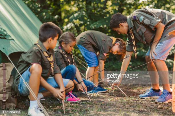 scouts building tent - cochlear implant stock pictures, royalty-free photos & images