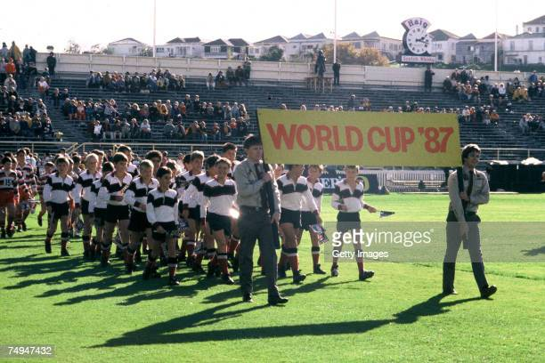 Scouts carry a World Cup '87 banner during the 1987 Rugby World Cup Opening Ceremony at Eden Park on May 22 1987 in Auckland New Zealand