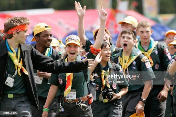 Scouts cheer as they attend the opening of the 21st World Scout Jamboree at Hylands Park on July 28 2007 in Chelmsford England