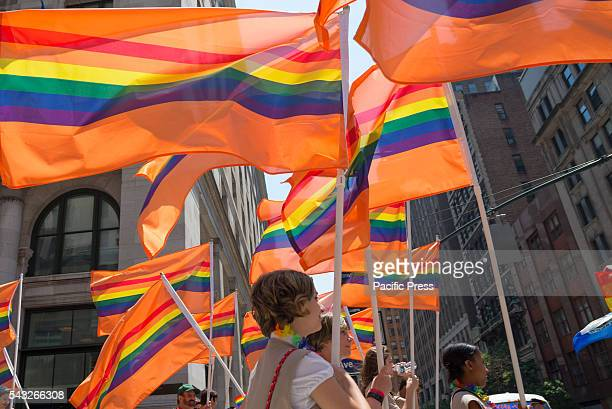 Scouts for Equality march in the parade carrying 49 orange flags in memory of the victims of the Pulse nightclub shooting Millions of spectators...
