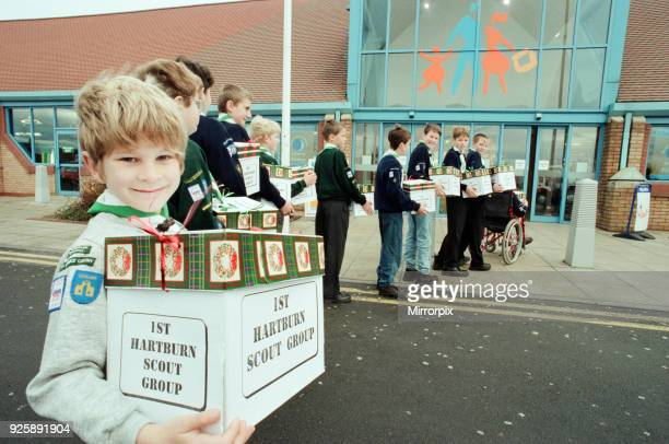 Scouts from Hartburn Scout group at SaverCentre Stockton helping with packing and carrying shopping to peoples cars for Scout funds 6th December 1997
