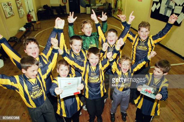 Scouts from Skelton who sent their old football strip to orphans in Poland pictured wearing new strips and certificate thanking them for their...