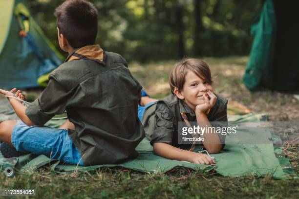 scouts in front of tent - cochlear implant stock pictures, royalty-free photos & images