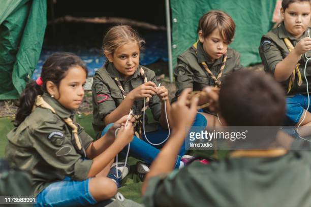 scouts learn to tie the knot - girl scout stock pictures, royalty-free photos & images
