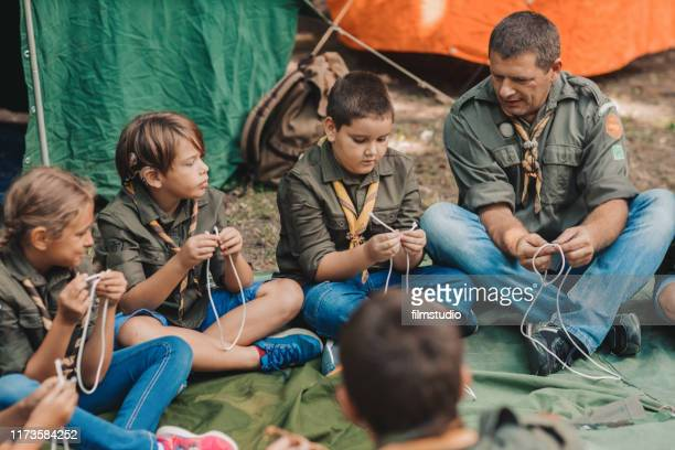 scouts learn to tie the knot - cochlear implant stock pictures, royalty-free photos & images