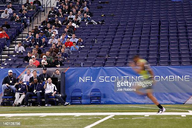 Scouts look on as a player runs the 40-yard dash during the 2012 NFL Combine at Lucas Oil Stadium on February 28, 2012 in Indianapolis, Indiana.