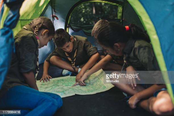 scouts looking at the map - girl scout stock pictures, royalty-free photos & images